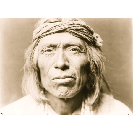 Head-and-shoulders portrait of Shiwawatiwa a Zuni Indian facing front Poster Print