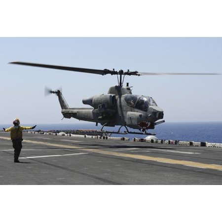 Red Sea July 23 2013 - An AH-1W Super Cobra helicopter takes off from the flight deck of the amphibious assault ship USS Kearsarge Poster Print