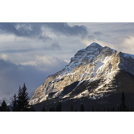 Sun Breaking Through The Clouds Partially Lighting A Snow Covered Mountain With Clouds In The Sky Kananaskis Country Alberta Canada Canvas Art   Michael Interisano  Design Pics  19 X 12