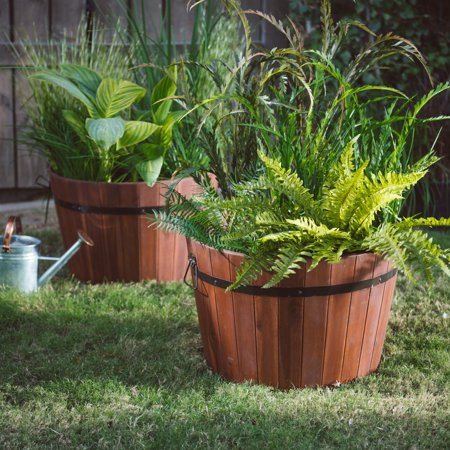 Coral Coast Loxley Wood Barrel Planter - 22L x 18D x 15H For a fun country-farmhouse touch in your garden or on your patio, add one or a two of the Coral Coast Loxley Wood Barrel Planter - 22L x 18D x 15H. This planter achieves a rustic look through hardy acacia construction in a barrel shape with black metal decorative straps. It offers plenty of room for your favorite flowers or herbs, and excellent drainage in the bottom keeps those plants healthy. You have the option of ordering a single planter or a set of two. This piece is a Hayneedle exclusive.