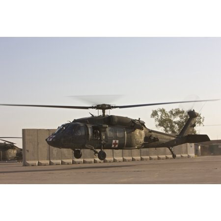 A US Army medevac UH-60 Black Hawk helicopter takes off from COB Speicher Tikrit Iraq Poster (Did The Us Take Oil From Iraq)