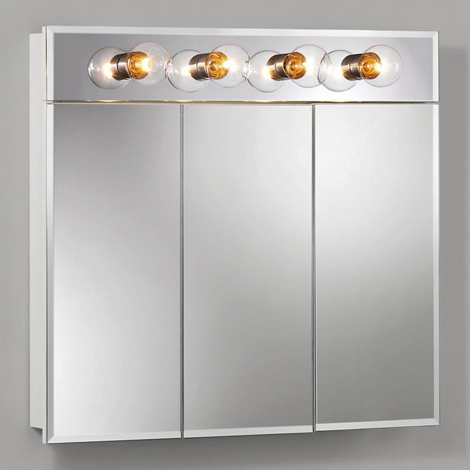 Jensen Medicine Cabinet Ashland Tri-View 4-Light 30W x 28H in. Surface Mount Medicine Cabinet 755435