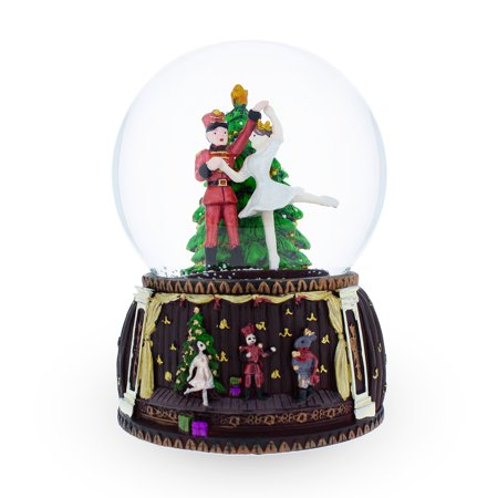 Nutcracker and Ballerina Dancing around Christmas Tree Musical Snow Globe ()