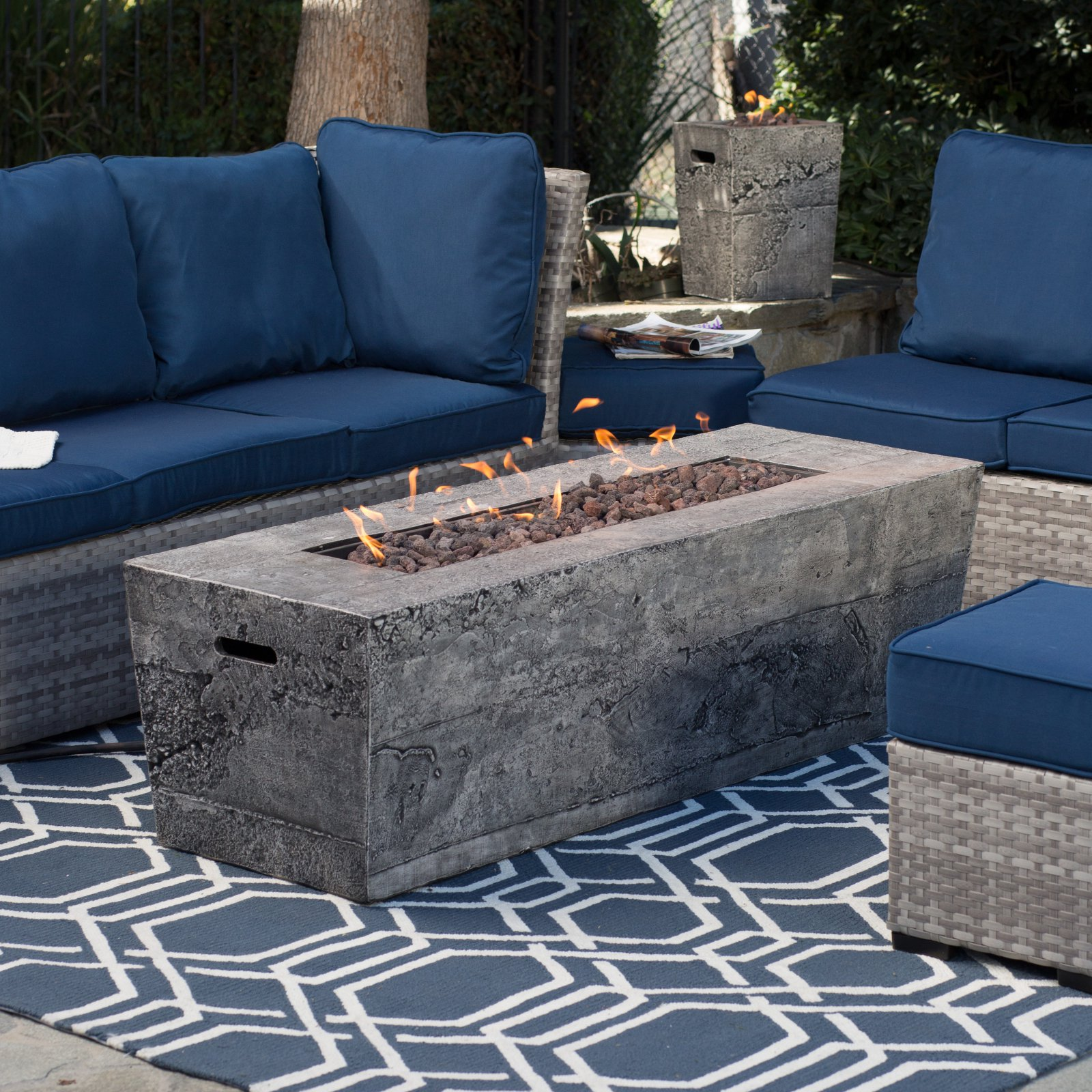 A long fire pit table that provides a perfect focal point for your patio furniture the red ember glacier stone 60 in gas fire pit table is powerful and