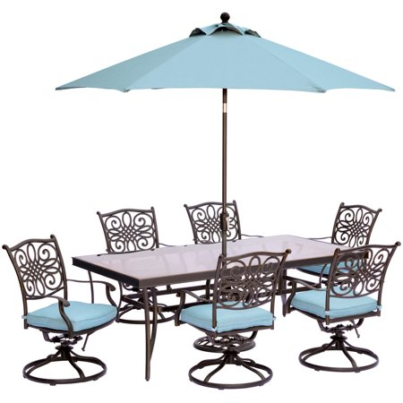 """Image of """"Hanover Outdoor Traditions 7-Piece Dining Set with with 42"""""""" x 84"""""""" Glass-Top Table, 6 Swivel Rockers and Umbrella w/Stand"""""""