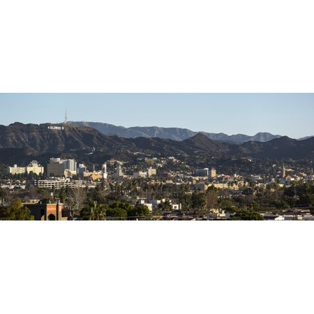 Elevated view of a city with mountain range in the background Hollywood City Of Los Angeles San Gabriel Mountains Los Angeles County California USA Poster
