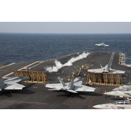 East China Sea November 14 2012 - An FA-18 Hornet launches from the the aircraft carrier USS George Washington Poster