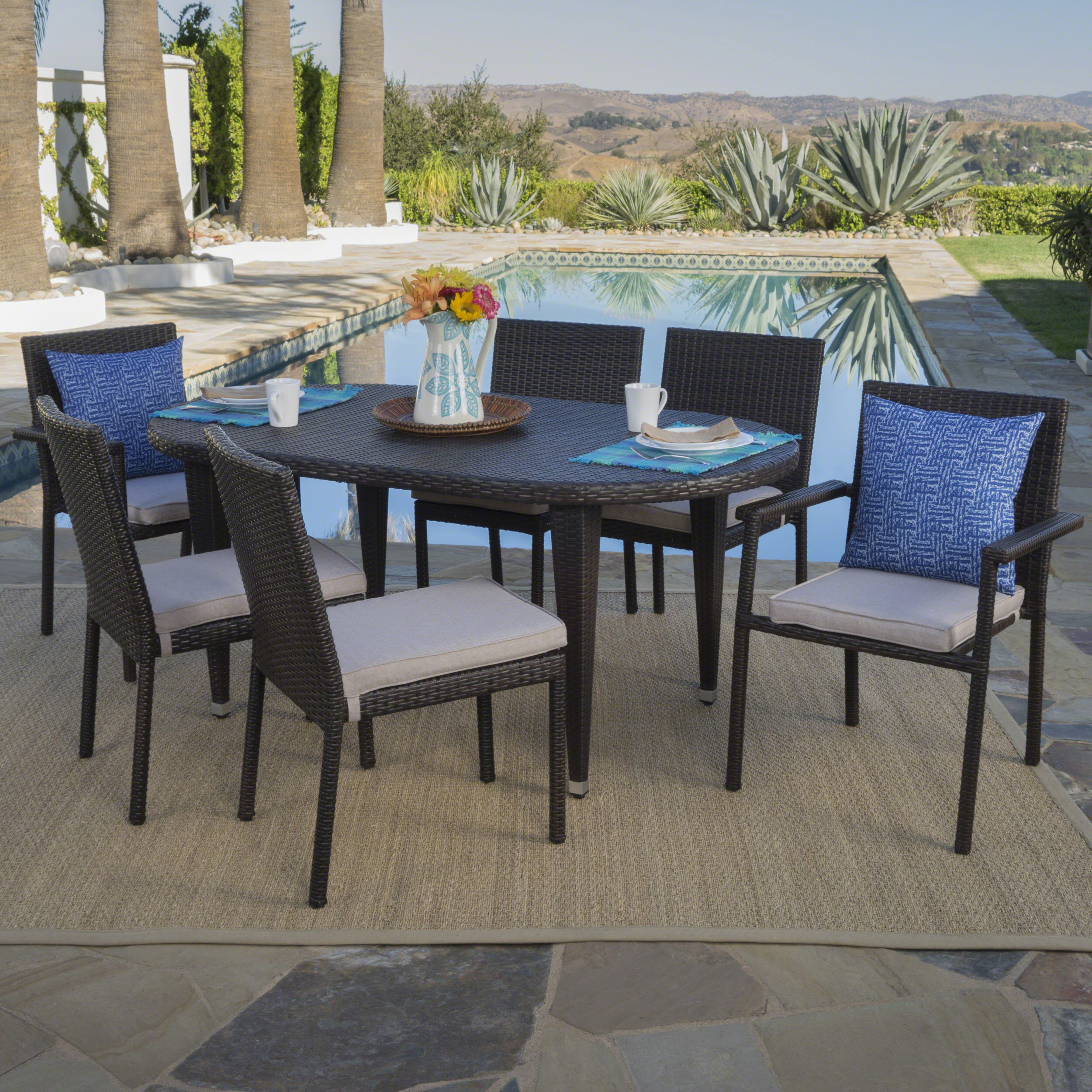 Pratt Outdoor 7 Piece Wicker Oval Dining Set with Armed and Armless Stacking Chairs and Cushions, Multibrown, Beige