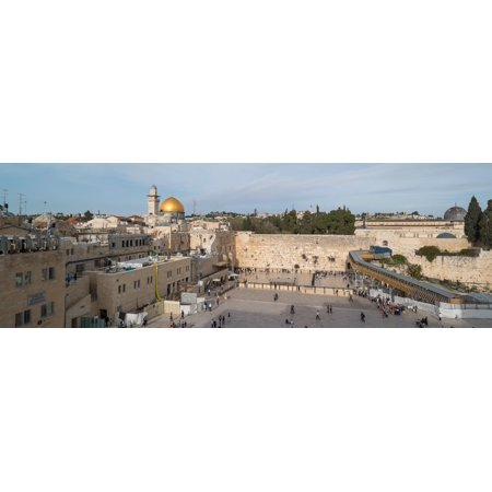 People praying at at Western Wall with Dome of the Rock and Al-Aqsa Mosque in the background Old City Jerusalem Israel Poster Print by Panoramic Images