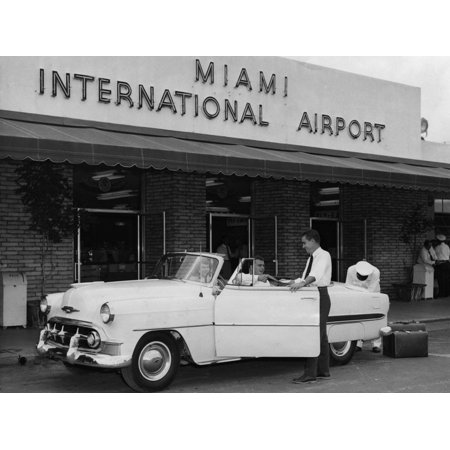 Travelers in a Chevy Bel Air Convertible at the Miami International Airport, 1954 August 22 Print Wall