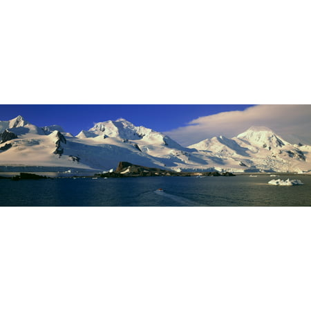 Panoramic view of ecological tourists in inflatable Zodiac boats snowy mountains glaciers and icebergs at Half Moon Island Bransfield Strait Antarctica Stretched Canvas - Panoramic Images (27 x 9)