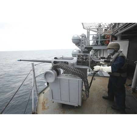 Atlantic Ocean February 6 2012 - Gunners Mate mans a Mk 38 25mm machine gun aboard the amphibious assault ship USS Kearsarge during exercise Bold Alligator 2012 Poster - Assault Machine Guns