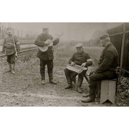 German militiamen play guitar and zither amusing themselves next to railroad tracks Poster (Next Track Order)