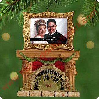 Mantels Decorated For Halloween (This keepsake ornament depicts a couple's first Christmas together - dated 2001. It shows a fireplace and has a place for you to put your photo in the picture frame)