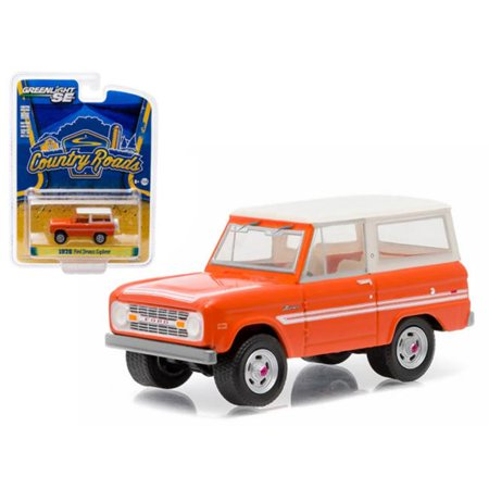 Greenlight 29830C 1 by 64 1976 Ford Bronco Explorer Package Country Roads Diecast Model Car, Orange