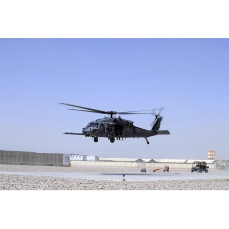 Teacher Afghan (An HH-60G Pave Hawk taking off from Camp Bastion Afghanistan Canvas Art - Stocktrek Images (34 x 23) )