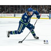 Brock Boeser Vancouver Canucks Unsigned Blue Jersey Shooting Photograph