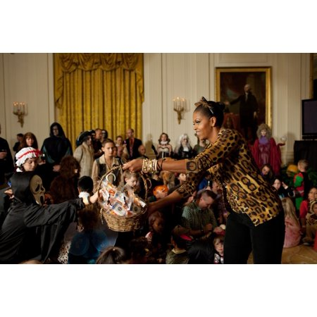 First Lady Michelle Obama Hands Out Treats During A Halloween Reception For Military Families And Children Of White House Staff In The East Room Of The White House Michelle Wears A Leopard Print Sweat