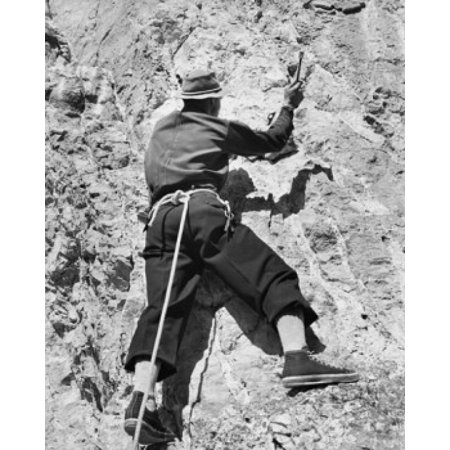 Rear view of a man climbing on a mountain Jackson Hole Wyoming USA Stretched Canvas -  (18 x 24)