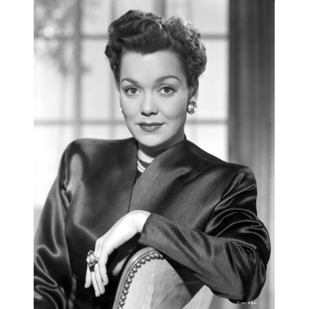 Jane Wyman sitting on the Chair in Black Velvet Long Sleeve Blazer and Pearl Earrings with Right Hand on the Top Railing Photo Print - Velvet Blazer