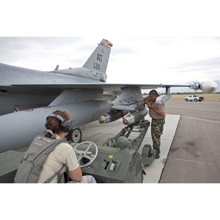 Weapons loaders from the 162nd Fighter Wing prepare to load a GBU-38 JDAM on an F-16 from the Air National Guard Air Force Reserve Test Center Poster Print - Item # (Florida Air National Guard 125th Fighter Wing)