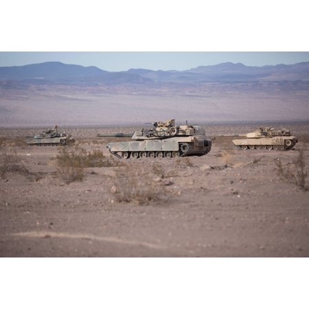 LAMINATED POSTER M1A1 Abrams Main Battle Tanks with Company B, 1st Tank Battalion, stage in the Blacktop training are Poster Print 24 x 36 M1a1 Abrams Main Battle Tank