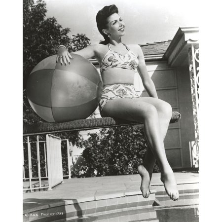 Photo Holding Ball - Ann Miller sitting on the Jumping Board Holding a Ball in a Classic Portrait Photo Print