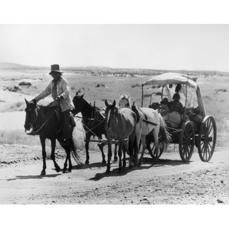 Navajo Carriage Na Navajo Man Leading A Horse Drawn Carriage On A Reservation In The Southwestern United States Photographed Circa 1920S Rolled Canvas Art     18 X 24