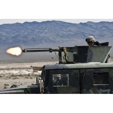 March 16 2011 - Airman fires a 50 caliber machine gun during a field training exercise as part of Desert Eagle on the Nevada Test and Training Range Poster
