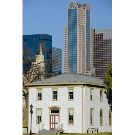 Skyscrapers behind an old house Old City Park Dallas Texas USA Poster Print ()