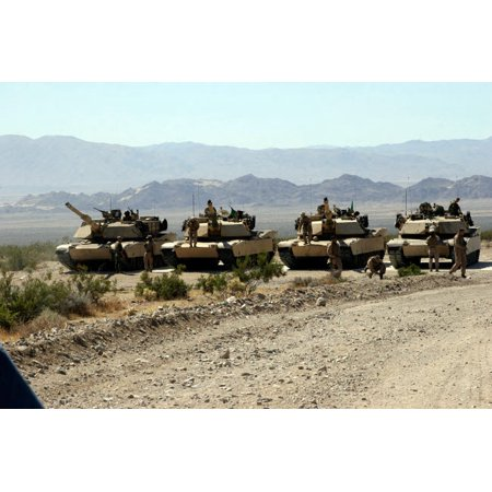 Marines gather around their respective tanks at the firing line Poster Print by Stocktrek Images