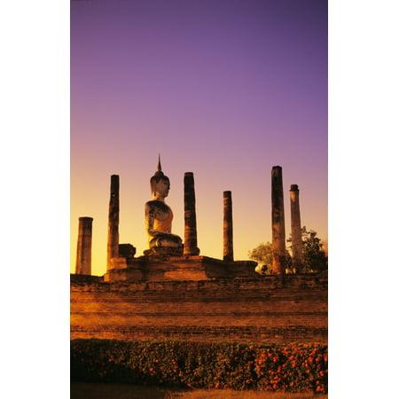 Thailand Sukhothai Glowing sunlight on structure of Buddha statue with many pillars at sunset Wat Mahathat Canvas Art - Richard Maschmeyer  Design Pics (22 x