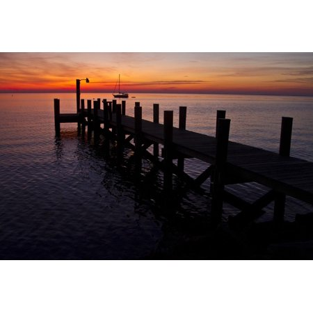 A Single Sailboat Sits on the Water of the Bay Alongside an Empty Dock on Tilghman Island, Maryland Print Wall Art By Karine (Sitting On The Dock Of The Bay Artist)