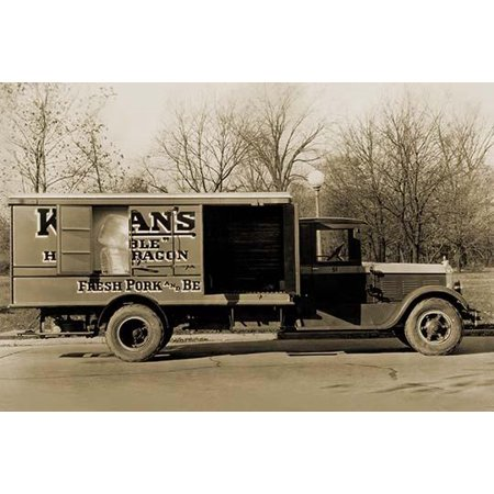 A photography of an early delivery truck  This insulated meat truck for Kingan & Co would hold blocks of ice to keep the meat fresh as it made its deliveries  The open side doors show the giant