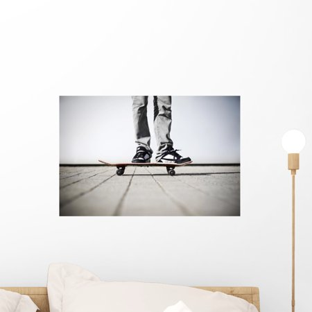 Skater Standing His Skateboard Wall Mural by Wallmonkeys Peel and Stick Graphic (18 in W x 12 in H) (Skateboard Wall Murals)