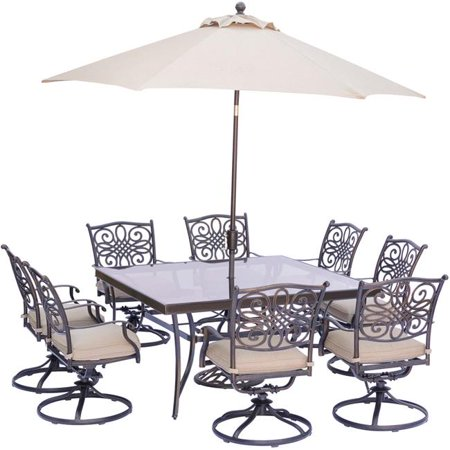 """Image of """"Hanover Outdoor Traditions 9-Piece Dining Set with 60"""""""" Square Glass-Top Table, 8 Swivel Rockers and Umbrella w/Stand in Natural Oat"""""""