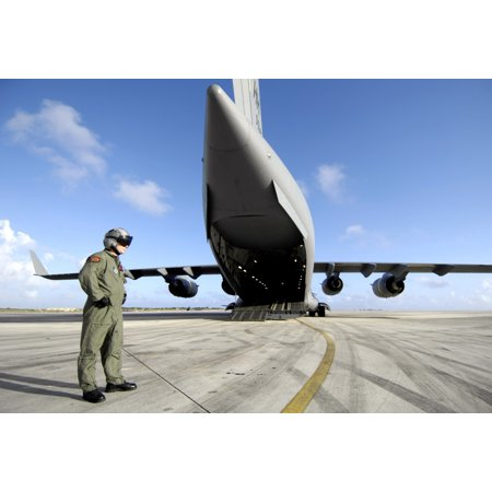 December 14 2006 - A soldier waits for his C-17 Globemaster III to launch on an upcoming airdrop mission at Andersen Air Force Base Guam Poster Print - Ship To Guam