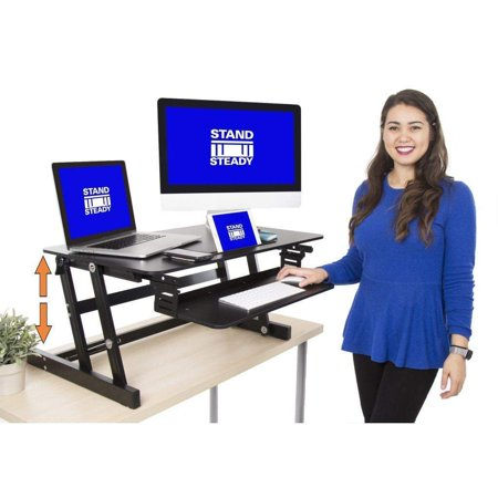 flexpro plus 31 standing desk | holds 2 monitors and retractable keyboard tray | adjustable height desk converter with bonus phone/tablet slot | from award winning stand steady | lightweight desk ()
