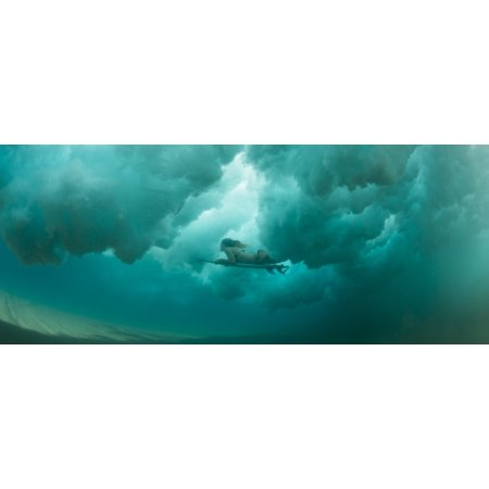Female surfer pushes under a wave while surfing Clansthal South Africa Stretched Canvas - Panoramic Images (27 x