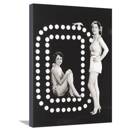 Two Models Posing by Large Letter O Stretched Canvas Print Wall Art By Everett Collection