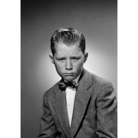 Portrait of displeased boy wearing suit and bow tie studio shot Canvas Art - (24 x 36)