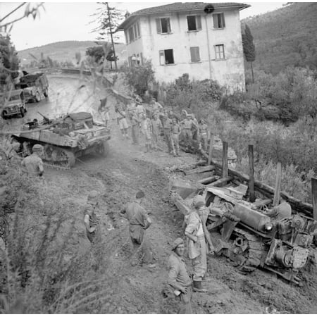 - LAMINATED POSTER The British Army in Italy 1944 A turretless Stuart reconnaissance tank towing a bulldozer which got Poster Print 24 x 36