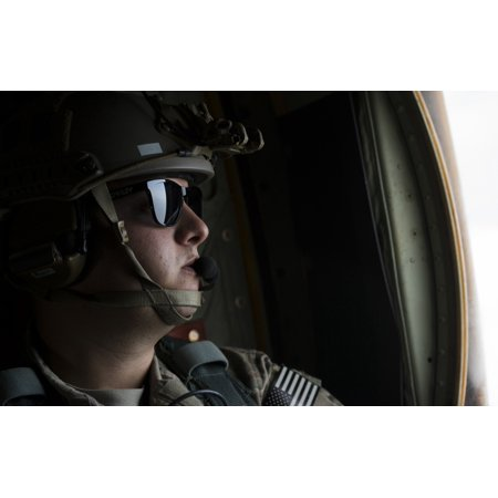 - April 22 2015 - US Air Force loadmaster looks out the window of a MC-130J Combat Shadow II during Exercise Emerald Warrior 2015 at Hurlburt Field Florida Poster Print
