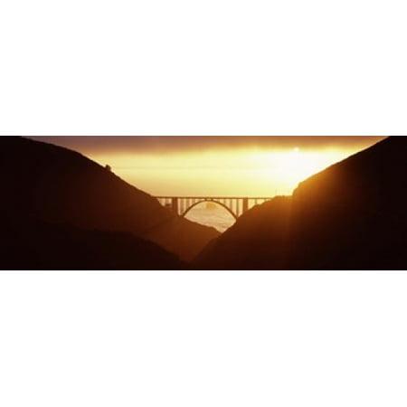 Silhouette of a bridge at sunset Bixby Bridge Big Sur California USA Poster - Bug Silhouette