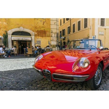 Alfa Romeo Duetto spider parked in a cobblestone street of Rome, Lazio, Italy Print Wall Art By Stefano Politi
