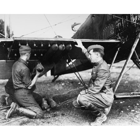Breguet Bomber Plane Nfrench Soldiers Loading A Breguet Bomber Biplane Photograph C1920 Rolled Canvas Art -  (24 x 36) Breguet Bomber Plane. /Nfrench Soldiers Loading A Breguet Bomber Biplane. Photograph  C1920. was reproduced on Premium Heavy Stock Paper which captures all of the vivid colors and details of the original. The overall paper size is 24.00 x 36.00 inches and the image size is  inches. This print is ready for hanging or framing.  Brand New and Rolled and ready for display or framing.  Print Title: Breguet Bomber Plane. /Nfrench Soldiers Loading A Breguet Bomber Biplane. Photograph  C1920.. Paper Size: 24.00 x 36.00 inches. Product Type: Rolled Canvas Art.