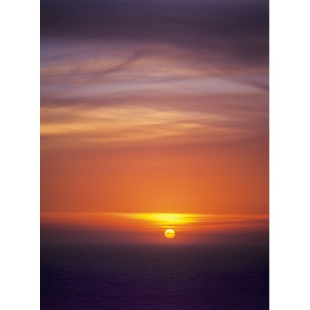 The sun sets over the Pacific Ocean Florence Oregon United States of America Poster Print by Robert L Potts  Design
