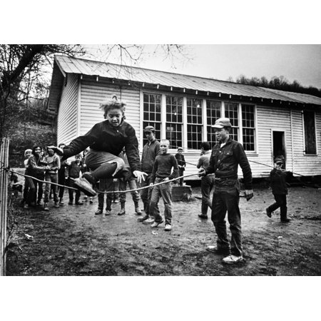 Tennessee Game C1970 Nschool Children Jumping Sticks Outside Buffalo School A One Room Schoolhouse In Clairfield Tennessee Photograph By Jack Corn C1970 Rolled Canvas Art     18 X 24