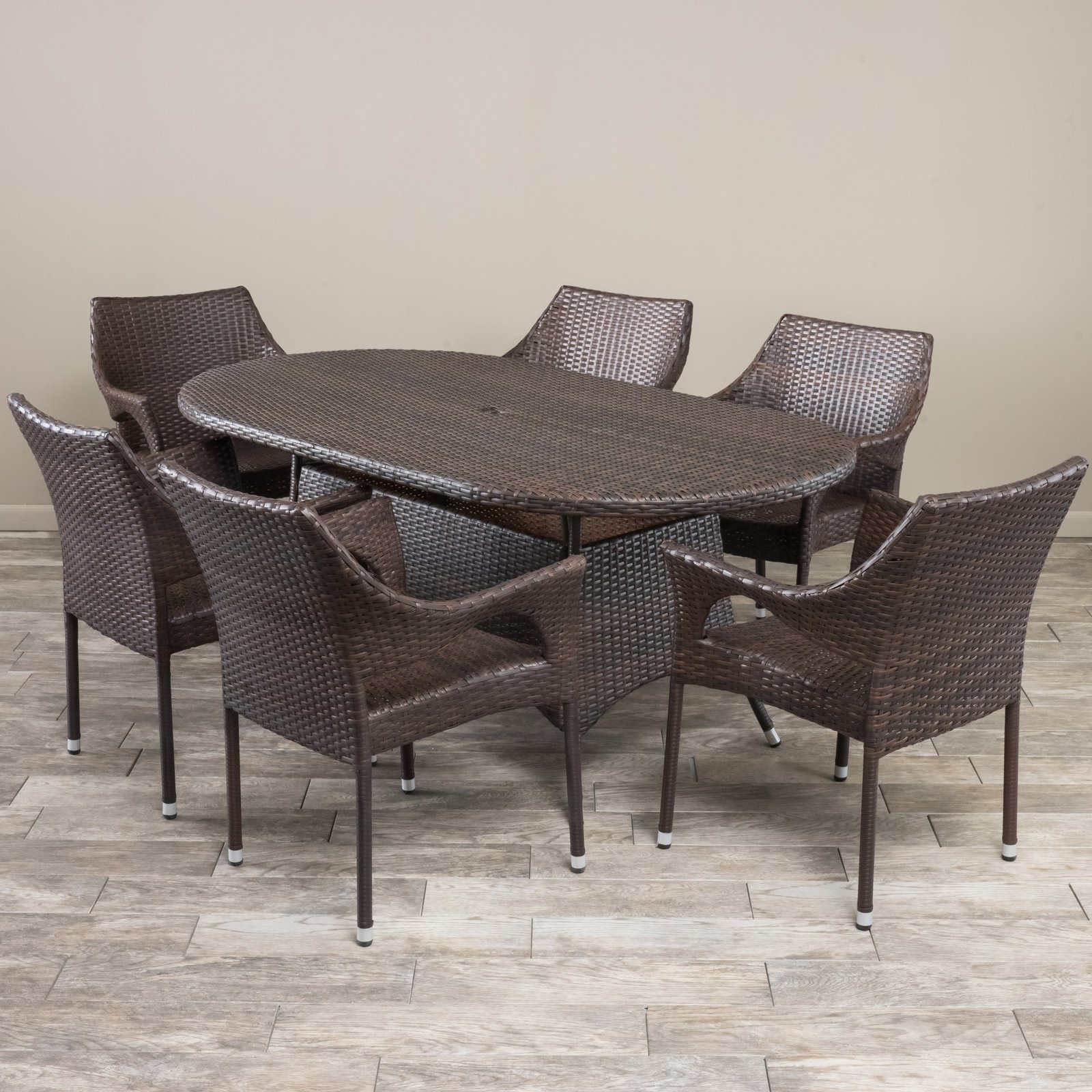 Daisy Wicker 7 Piece Oval Patio Dining Set