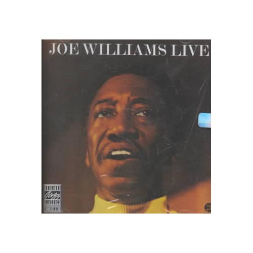 """Personnel: Joe Williams (vocals); Nat Adderley (cornet); Cannonball Adderley (alto saxophone); George Duke (piano); Walter Booker (guitar, bass); Carol Kaye (bass); Roy McCurdy (drums); King Errisson (conga).<BR>Recorded live at Fantasy Studios, Berkeley, California on August 7, 1973. Originally released on Fantasy (9441).<BR>Digitally remastered by Phil De Lancie (1990, Fantasy Studios, Berkeley, California).<BR>This 1973 session, recorded live before a studio audience in Berkeley, California, is a collaboration between remarkable jazz blues vocalist Williams-here well into his solo career-and saxophone legend Cannonball Adderley. Members of Adderley's band provide musical support. The tracks are a wonderful mixture of blues, jazz standards, and such socially relevant songs as Tom McIntosh's enormously moving """"Yesterday, Today, and Tomorrow""""-certainly one of the highlights of this historic session. Another great treat is the almost operatic """"All Blues/Goin to Chicago Blues/ C.C. Rider,"""" a never-before-released medley that closes the CD. LIVE is excellent work by some excellent artists."""